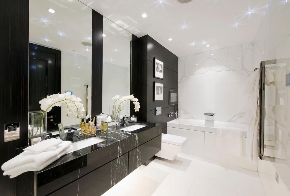 حمام أبيض و أسود 2 الأبيض والأسود.. أناقة وتميز في حمامك
