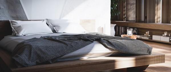 cozy grey quilt 600x253 تصاميم غرف نوم لأصحاب الذوق الرفيع