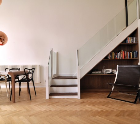warm-modern-living-room-under-stairs